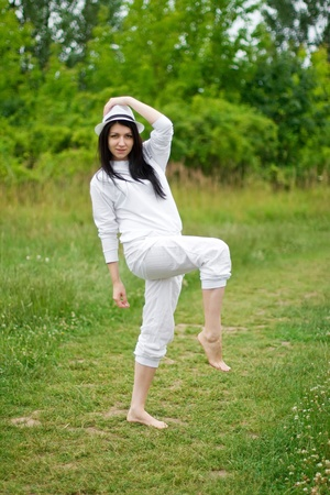 A young woman posing on the path throw meadows photo