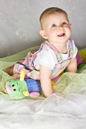 Crawling baby girl and her toy caterpillar