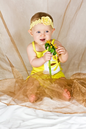 tell fortunes: Baby holding flower and tell fortunes about love