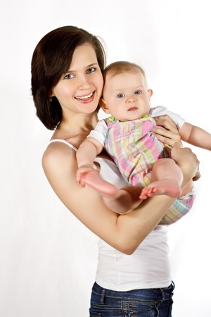 Smiling young mother and baby Stock Photo