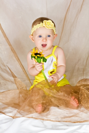 Baby smiling and holding flower Stock Photo - 15413009