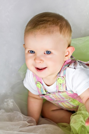 Funny baby girl crawling and smiling