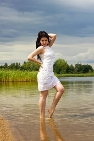 Sexy summer girl on the lake shore Stock Photo - 15427258