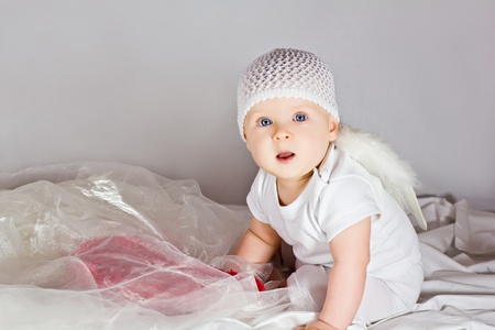 Cute little girl wearing white angel wings photo