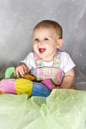 Happy baby girl with her toy  photo