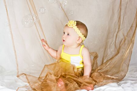 Soap bubbles and astonished adorable baby Stock Photo