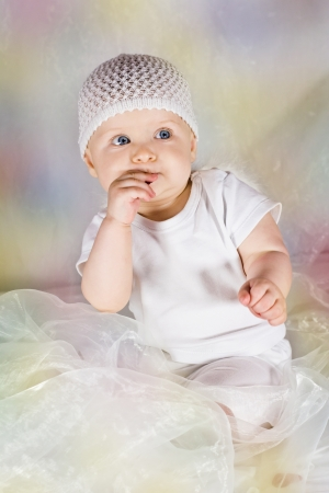 Little cute baby eating something Stock Photo - 15603553