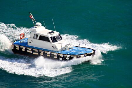 Pilot boat in action in the mediterranean sea photo