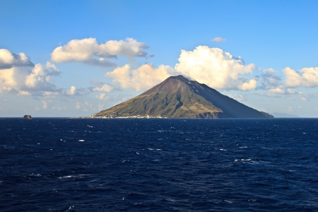 View of the Stromboli volcano over the sea Stock Photo