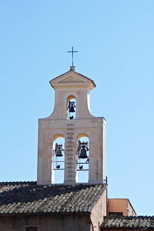 A church spire with belfry in Rome, Italy photo