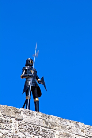 Knight armour on the medieval building in Rhodes, Greece Stock Photo - 16540013