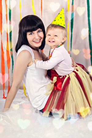 Portrait of mother with birthday girl photo