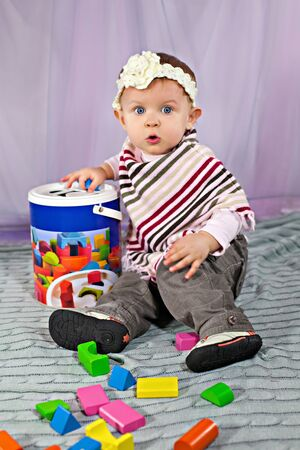 developmental: Cute baby girl sitting and playing with developmental toy Stock Photo