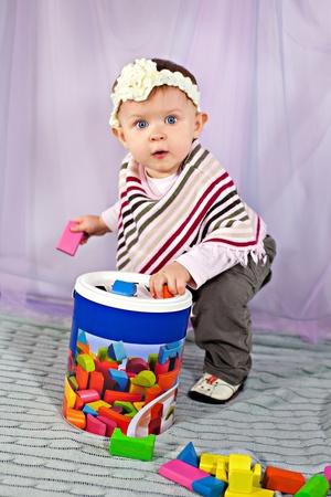 developmental: Cute baby girl playing with developmental toy