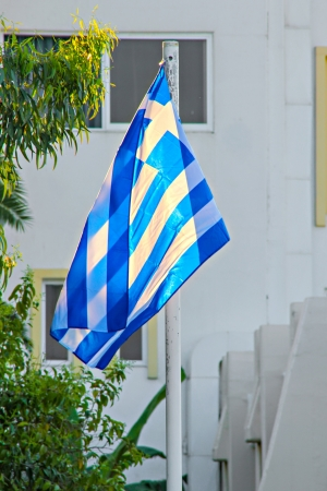 National flag of Greece in front of hotel photo
