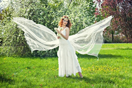 Romantic beautiful woman with flying fabric like the angel wings Stock Photo