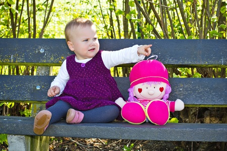 Cute little girl with her doll Stock Photo - 20772670