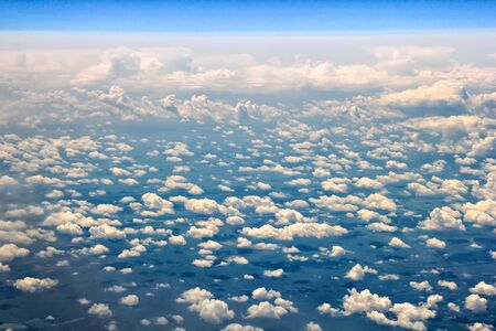 airplane window: View from an airplane window, flying above white clouds