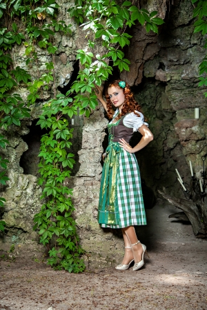 Beautiful german woman wearing dirndl photo