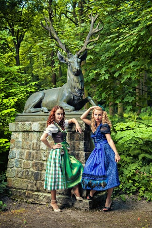 Two young beautiful Bavarian girls in Oktoberfest Dirndl cloth photo