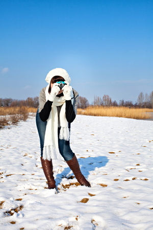Girl taking a photo in winter photo