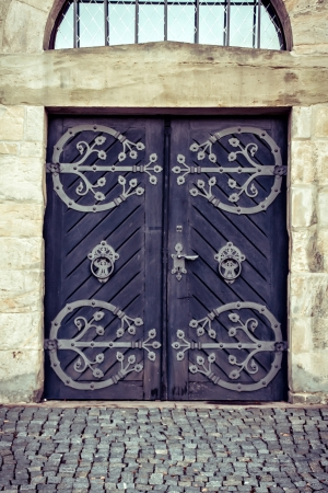 iron nail: Wooden old door with wrought-iron elements