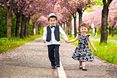 Little boy and girl in a romantic scene in nature Stock Photo