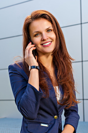 Young businesswoman outdoor speaking on mobile phone photo
