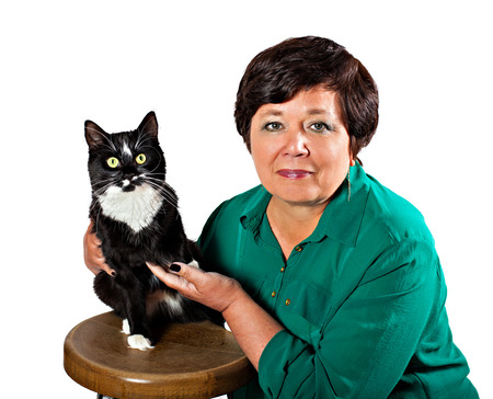 Mature woman with cat isolated on white background Stock Photo