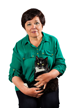 Mature woman with cat isolated on white background photo