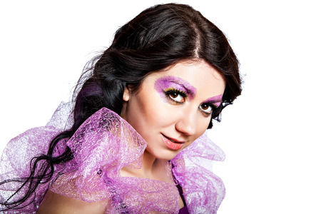 Sensual beautiful girl with violet shiny glitter make-up Stock Photo