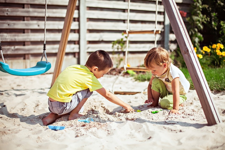 Children playing with sand on the playground