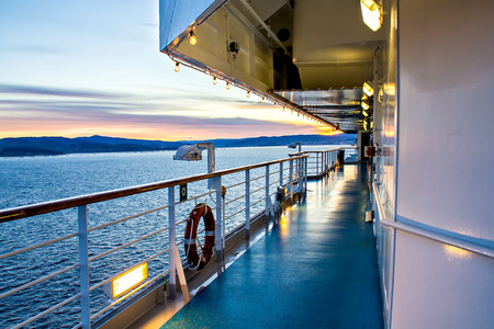 View from deck of cruise ship, sunset photo