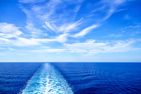 Cruise ship wake or trail on ocean surface Stock Photo