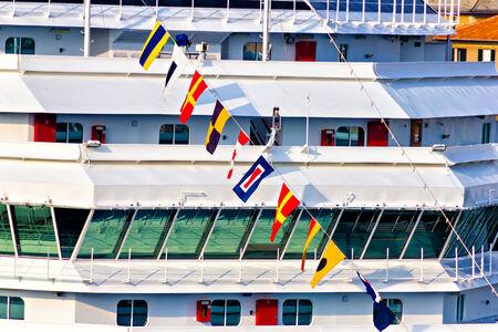 Marine flags (flaggenalfabet) hanging on cruise ship photo