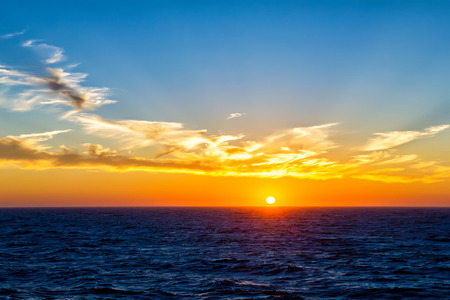 Beautiful sunset over an ocean photo