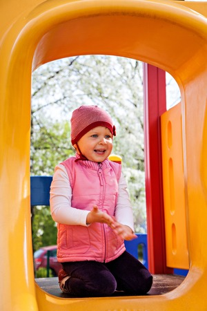 action girl: Pretty little girl on playground in park