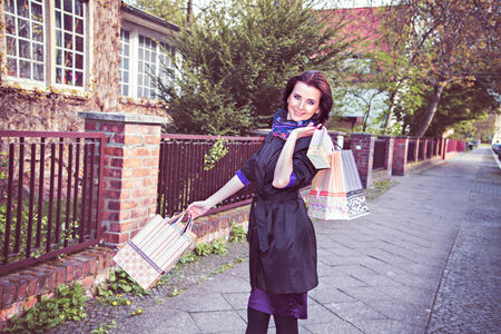 Happy young woman after great shopping Stock Photo