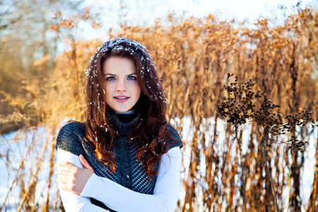 thicket: Woman with snow on hair in winter park