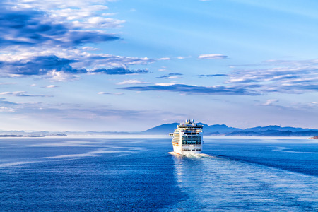 The cruise white liner sailing on the sea photo