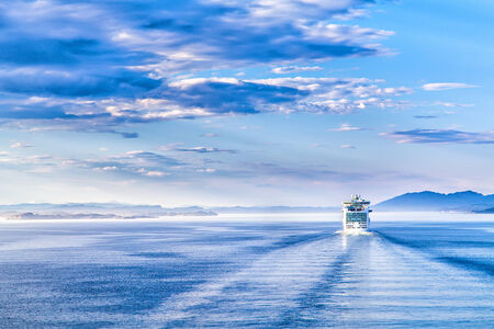 The white liner sailing on blue water photo