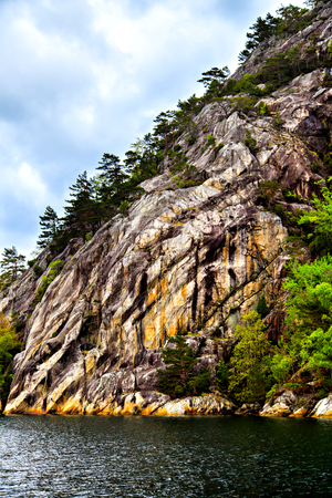 The picturesque landscape: rocks, trees and sea Stock Photo
