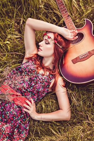 hippie woman: Romantic girl travelling with her guitar. Summer. Hippie style. Stock Photo
