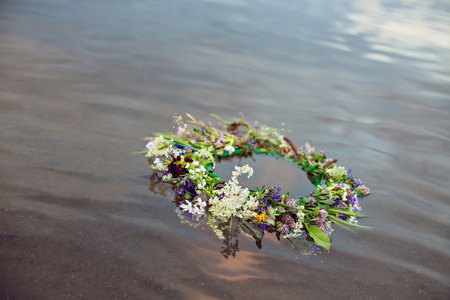 Wreath floating on water, tradition Kupala night pagan rituals