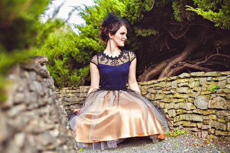 petticoat: Portrait of elegant brunette in park, Harz, Germany Stock Photo
