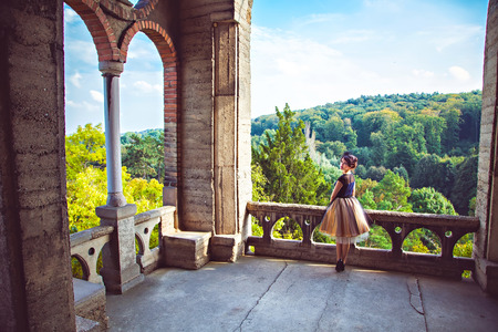 petticoat: Young charming lady in vintage dress on the balcony of the castle in Roseburg, Germany