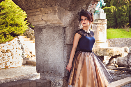 petticoat: Young lady in vintage dress near the column of the castle Roseburg, Harz, Germany