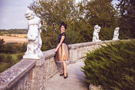 petticoat: Portrait of elegant brunette by the balustrade outdoor, Harz, Germany