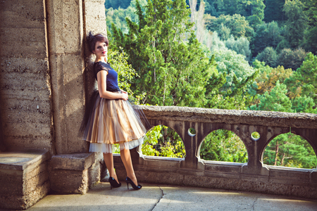 petticoat: Young lady in vintage dress on the terrace of the castle, Harz, Germany