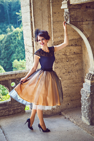 petticoat: Young refined lady on the balcony of the castle, Harz, Germany Stock Photo